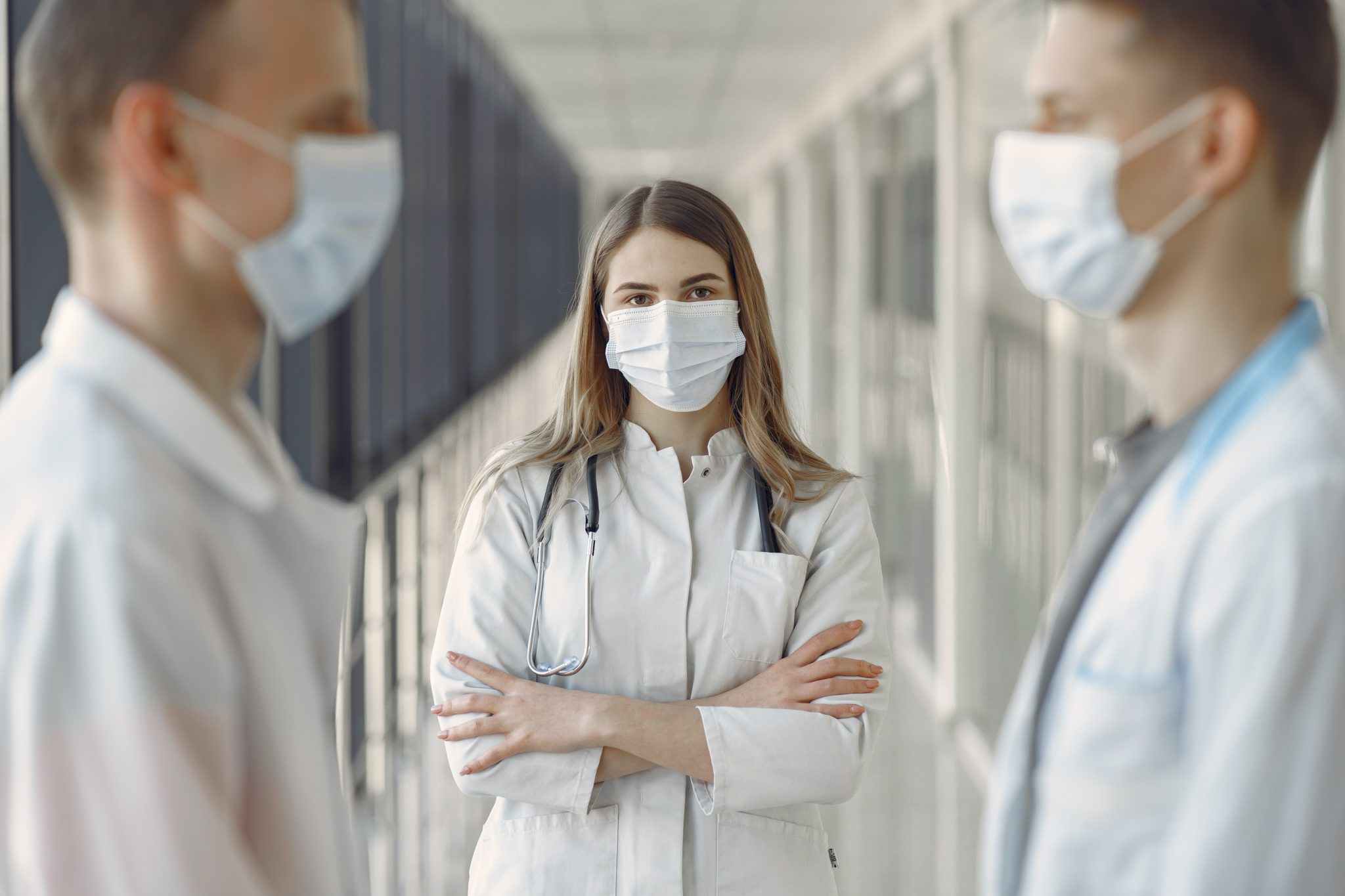 a nurse wearing a facemask and thinking about medical technology